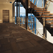 Commercial-grade Feltex tiled carpet in Moonstruck from the floor, flooring, handrail, stairs, wood, black