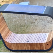 Solar panels on the roof of Sedi Connect chair, furniture, plywood, table, wood, gray
