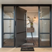 A robust industrial-style front door sets the scene