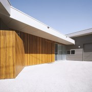 Warm timber cladding welcomes you to the entry