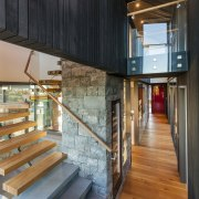 The open staircase facilitates views and natural light