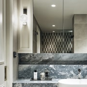Marble slabs and intricate tile detailing is layered