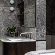 A wall splits the ensuite in two, acting