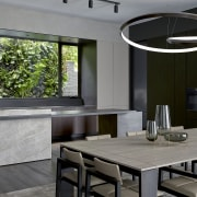Contemporary adjacent furniture and lighting are the perfect