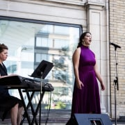 A classical performance at the Royal Ontario Museum's bowed string instrument, dress, event, music, musician, performance, pianist, recital, street performance, gray