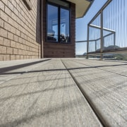 The True Tough Deck  Terrain By TimberTech architecture, building, daylighting, facade, floor, flooring, line, property, real estate, road surface, roof, structure, window, wood, gray