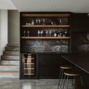 The kitchen's open timber shelving links to the architecture, building, cabinetry, ceiling, countertop, cupboard, floor, flooring, furniture, home, house, interior design, kitchen, property, room, shelf, shelving, tile, wood, black, gray