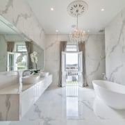 The main, marble-look bathroom exudes a five star