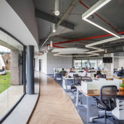 Titan Bangalore Workplace Open Office Purnesh 6 - architecture, building, ceiling, floor, flooring, furniture, home, house, interior design, office, property, real estate, restaurant, room, table, gray