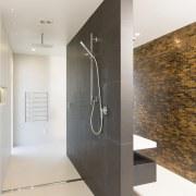 The master suite's designer ensuite has a walk-through bathroom, interior design, plumbing fixture, tile, white, master ensuite, walk through shower, GJ Gardner Homes