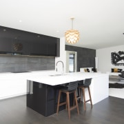 This GJ Gardner home includes a spacious entertainer's countertop, furniture, interior design, kitchen, room, table, white