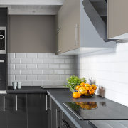 Trendse News may19 1 - architecture | building architecture, building, cabinetry, ceiling, countertop, exhaust hood, floor, flooring, furniture, home, house, interior design, kitchen, kitchen appliance, kitchen stove, material property, microwave oven, property, room, tile, yellow, gray, white, black
