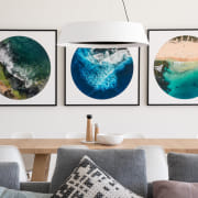 Selected artworks provide splashes of colour within the aqua, art, design, furniture, interior design, living room, modern art, room, space, table, teal, turquoise, wall, white