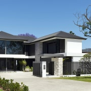 The home's plaster, tinted glass, and stone make