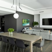 Beyond the large open-plan living/dining/kitchen space, a rumpus