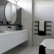The master ensuite is cool and contemporary in
