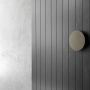 The solid front door opens to a dramatic