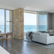Wood floors and a stone-clad pillar are two