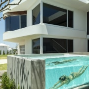 A raised glass-sided pool makes for a beautiful