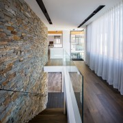 The stone wall is a feature upstairs as