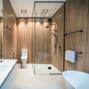 In the bathrooms, large-format timber-look porcelain tiles are