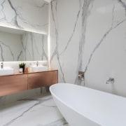 For this bathroom, designer and developer Cameron Ireland architecture, bathroom, floor, home, interior design, room, tap, tile, wall, gray, vanities, vanity