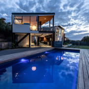 The Wall House, by MCAS, showcases an artistically architecture, backyard, blue, building, cloud, design, estate, home, house, leisure, property, real estate, reflecting pool, residential area, roof, sky, swimming pool, vacation, villa, blue, teal
