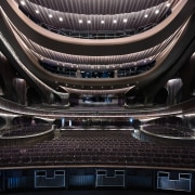 Xiqu Centre's breathtaking 1,073-seat Grand Theatre. architecture, automotive design, automotive exterior, building, ceiling, metal, opera house, performing arts center, stage, black