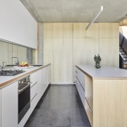 This kitchen's lighting is all LED with a architecture, building, cabinetry, ceiling, countertop, floor, flooring, furniture, home, house, interior design, kitchen, loft, material property, plywood, property, real estate, room, wood, yellow, gray