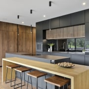 The solid timber casual-dining island benchtop complements the