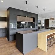 The kitchen's tones and finishes work well with