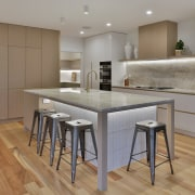 The kitchen island allows for several to sit