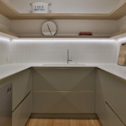 The scullery includes open display shelving and concealed
