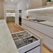 Custom cabinetry further maximises storage with internal drawer