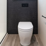 Beton Black Swan Hex Mosaic tiles also feature