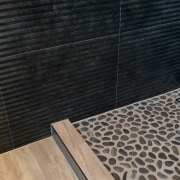 The master bathroom's various tile solutions look even