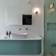 The ensuite retains consistency with the bathroom through
