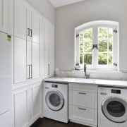 The laundry is replete with hand-crafted cabinetry solutions