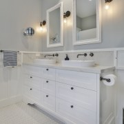 The bathroom vanity elegantly continues the Colonial theme