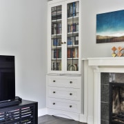 The lounge benefits from built-in colonial-style cabinetry, complete