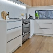 Wood cabinetry harmonises with the look of the