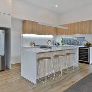 High-end wood-look tile meets warm, neutral-toned carpet.