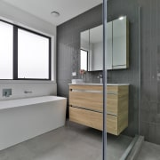 The family bathroom has Lusso Pearl 600x600mm for