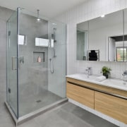 The tiled master ensuite achieves a relaxed feel