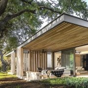 Each Plains House at the lodge has a architecture, botany, building, ceiling, cottage, estate, facade, farmhouse, home, house, pavilion, porch, property, real estate, residential area, roof, room, shade, siding, tree, wood, yard, brown
