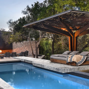 Sculptural raw rusted steel pool pavilions, inspired by architecture, backyard, building, design, estate, furniture, home, house, interior design, landscape, landscaping, leisure, patio, property, real estate, reflecting pool, residential area, resort, roof, room, shade, sunlounger, swimming pool, tree, villa, yard, black