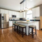 The kitchen floor is one of the most cabinetry, countertop, cuisine classique, floor, flooring, hardwood, interior design, kitchen, laminate flooring, real estate, room, wood, wood flooring, white