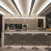 A three pendant lighting arrangement is ideally situated countertop, cuisine classique, interior design, kitchen, gray, black