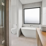The master ensuite includes a luxurious tiled shower