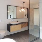 Clean-lined and understated, this modest-sized bathroom features a bathroom, bathroom accessory, bathroom cabinet, home, interior design, property, real estate, room, sink, gray